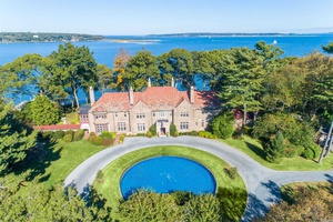 This historic water front estate is perfectly situated on 5 lush acres overlooking Lloyd Harbor.